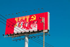 Outdoor billboard with political communist propaganda, Saigon. Royalty Free Stock Photos
