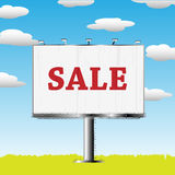 Outdoor billboard with sale sign. Grand outdoor billboard with sale sign over cloud background Stock Image