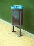 Outdoor bin. A classic outdoor garbage bin in classic dark green color with light green plastic bag Stock Photography