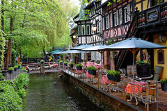 Outdoor bistro waterside in Swiss themed area Royalty Free Stock Photography