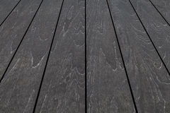 Outdoor black wooden floor pattern Royalty Free Stock Image