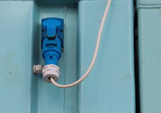 Outdoor Blue Electrical Mount Plug with White Wire Royalty Free Stock Photo