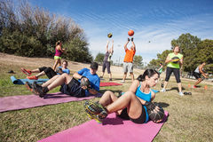 Outdoor Bootcamp Fitness Class stock photos