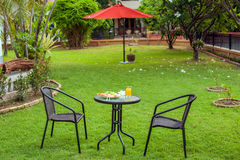 Outdoor breakfast in the courtyard Royalty Free Stock Photo