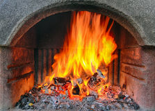 Outdoor brick fireplace with a fire blazing inside Royalty Free Stock Images