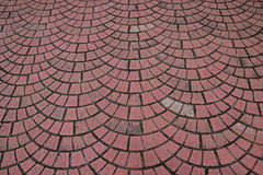 Outdoor brick like Pavement laid as repeated semicircle pattern Stock Photo