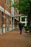 Outdoor brick sidewalk with pedestrians. In alexandria va Stock Images