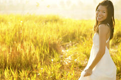 Outdoor Bride. Asian bride at outdoor in a morning surrounding by golden sunlight Stock Image