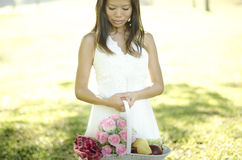 Outdoor Bride. Asian bride at outdoor in a morning Royalty Free Stock Photo