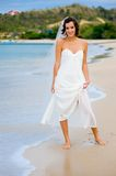 Outdoor Bride. A young bride in wedding dress on a tropical beach Stock Photo