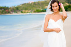Outdoor Bride. A young bride in wedding dress on a tropical beach Royalty Free Stock Image