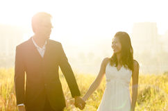 Outdoor Bride and Groom. Surrounding by natural morning golden sunlight Stock Image