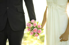 Outdoor Bride and Groom. Holding flower bouquet Stock Photos
