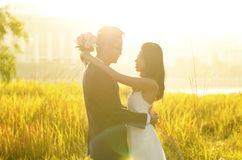 Outdoor Bride and Groom. Surrounding by natural morning golden sunlight Stock Images