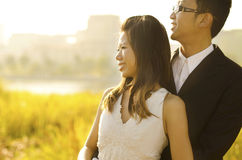 Outdoor Bride and Groom. Surrounding by natural morning golden sunlight Royalty Free Stock Photos
