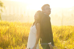 Outdoor Bride and Groom,. Surrounding by natural morning golden sunlight Royalty Free Stock Image
