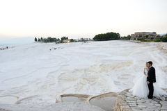 Outdoor Bride and groom. The groom and bride in the pamukkale Royalty Free Stock Images