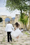 Outdoor Bride and Groom. Outdoor bride walking in the pamukkale, hierapolis morning golden sunlight Royalty Free Stock Photography