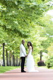 Outdoor Bride and groom. The groom and bride walking in the park Royalty Free Stock Photos