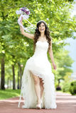 Outdoor Bride smiling. Outdoor bride walking in natural park Royalty Free Stock Image