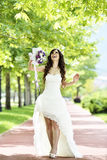 Outdoor Bride smiling. Outdoor bride walking in natural park Royalty Free Stock Photography