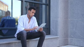 Outdoor Browsing on Tablet Computer, Young Black Handsome Man. Creative designer , businessman stock video footage