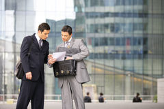 Outdoor business meeting. Businessmen negotiating in front of a building Royalty Free Stock Photo