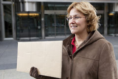 Outdoor business woman with blank sign horizontal.  Stock Photography