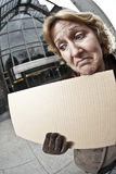 Outdoor business woman with blank sign vertical.  Royalty Free Stock Images