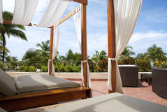Outdoor Cabana Beds in the Tropics. First person perspective view from an outdoor cabana bed on a Caribbean resort balcony Stock Photos