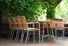 Outdoor café table by the grapevine Royalty Free Stock Image