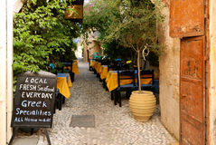 Outdoor cafe. In old greek town stock photo