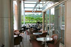 Outdoor cafe. Tropical greenery stock image
