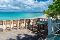 Outdoor cafe on the beach of Barbados, Caribbean Stock Photo