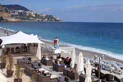 Outdoor cafe on the beach of Nice, France. Royalty Free Stock Photography
