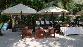 Outdoor cafe on beach ready welcoming guests. stock video