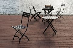 Outdoor cafe. Chairs and tables in outdoor cafe at seaside promenade Royalty Free Stock Photos