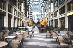 Outdoor cafe at the city center. Business lunch at the open air. Modern interior of restaurant Royalty Free Stock Photos