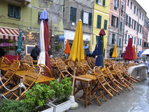 Outdoor cafe closed on a rainy day in Italy. Stock Photos