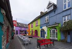 Outdoor cafe among colorful buildings Stock Images