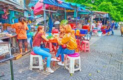 In outdoor cafe in Mahanak Fruit Market, Bangkok, Thailand