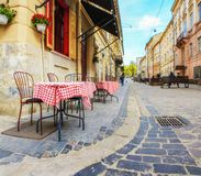 Outdoor cafe in the old town. Summer cafe in the narrow old street. stock photos