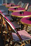 Outdoor cafe, Paris. Typical outdoor cafe with tables and chairs on the sidewalk in Paris, France Royalty Free Stock Photo
