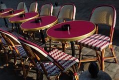 Outdoor cafe, Paris. Typical outdoor cafe with tables and chairs on the sidewalk in Paris, France Stock Photo