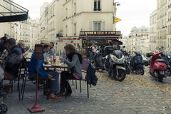 Outdoor cafe, Paris, France. Patrons at outdoor cafe in Paris, France Royalty Free Stock Photos