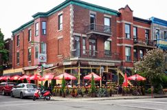 Outdoor Cafe in Red Brick Buildings with Patio Royalty Free Stock Photo