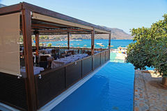 Outdoor cafe, resort pool and Mediterranean sea (Crete, Greece) Stock Photo