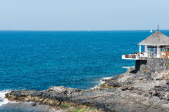 Outdoor cafe on rocky cliff at Las Americas Stock Images