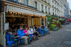 Outdoor cafe in the Rue Cler neighborhood in Paris Royalty Free Stock Photos