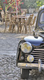 Outdoor cafe scene with old car Royalty Free Stock Photos